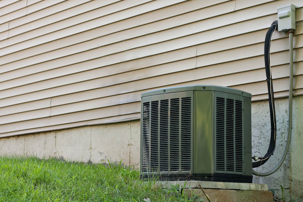 Air conditioner unit outside a house