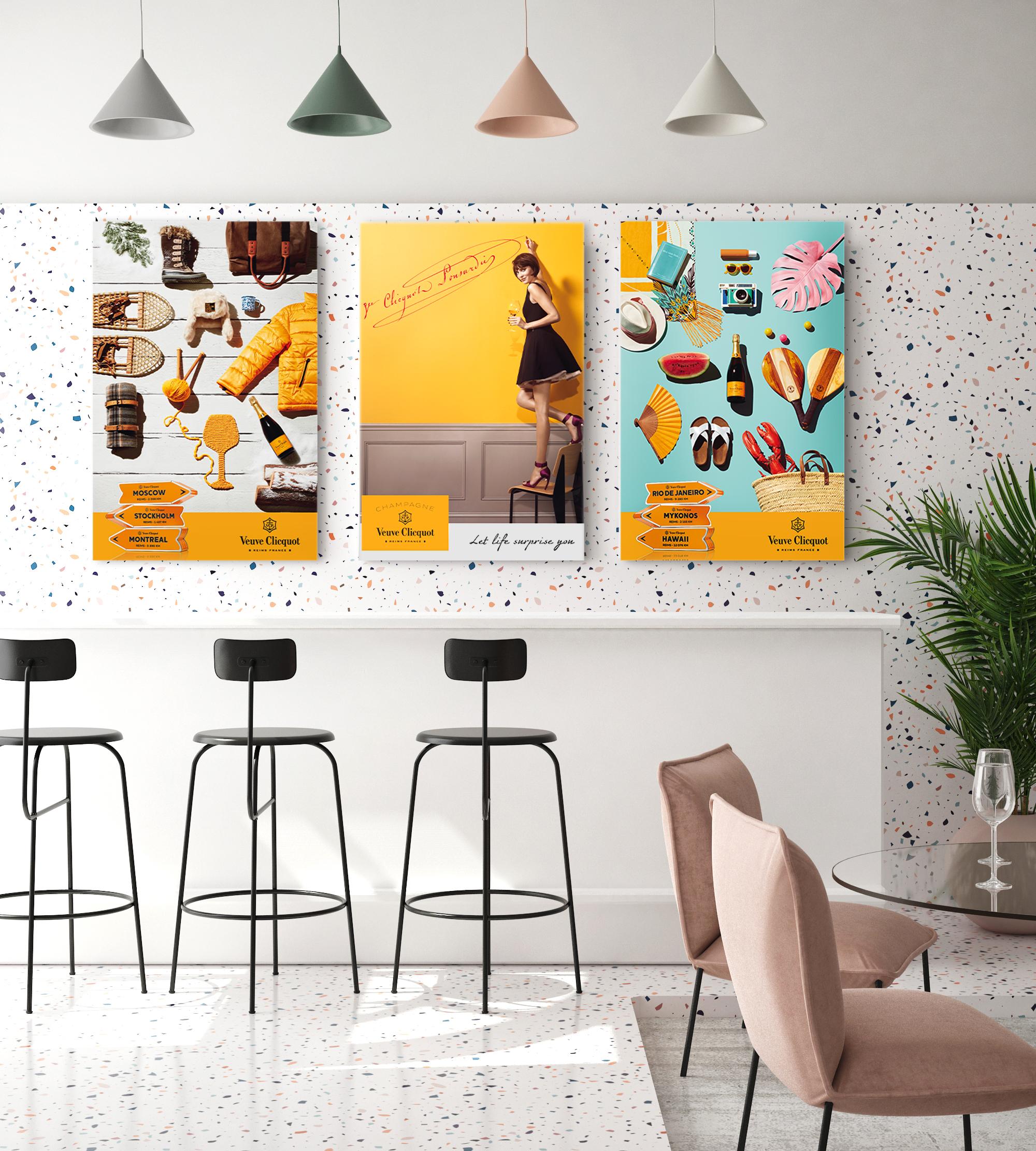 Three wall mounted prints hanging in a communal workspace area