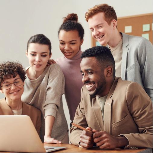 People joyfully looking at a computer watching their revenues increase