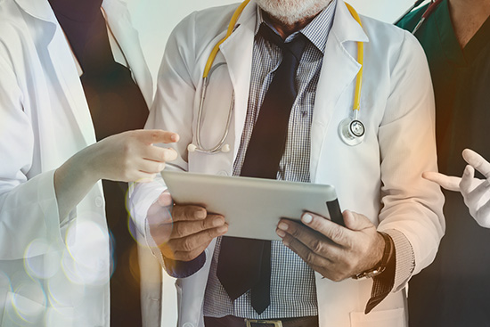 Clinician Education - Doctors discussing medical records