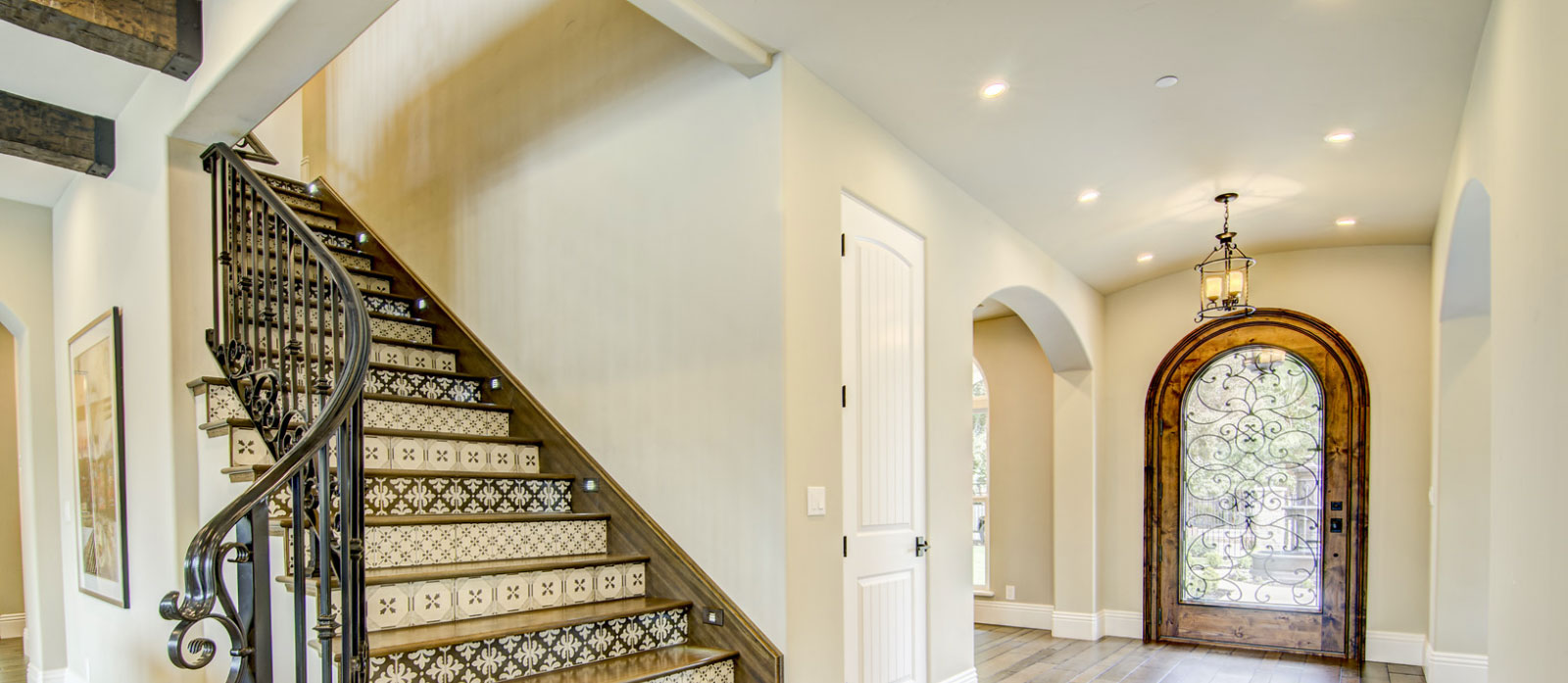 A view of the entryway and a staircase in a custom built home