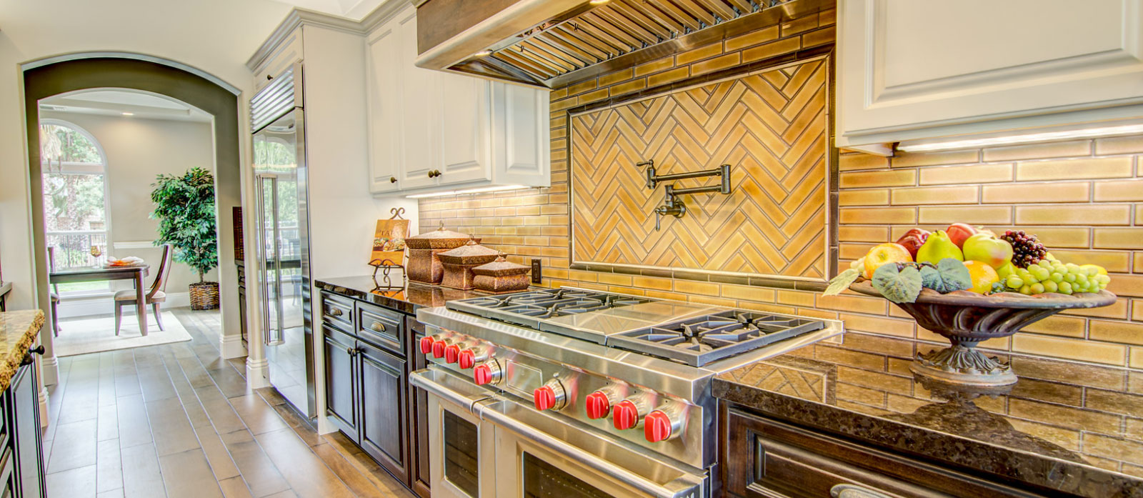 stove top and its surroundings  in a kitchen in a custom built home