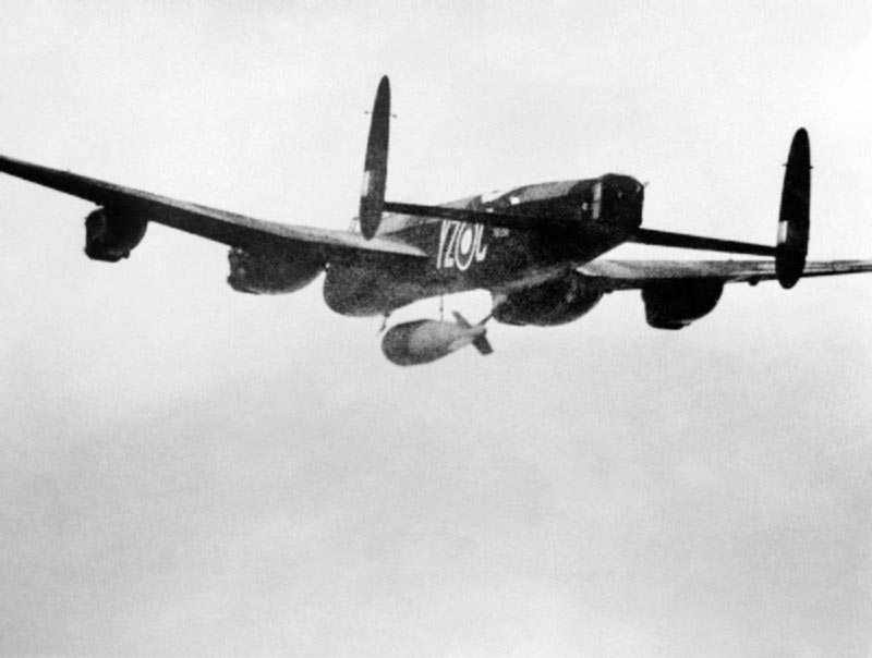 A Lancaster Bomber airplane dropping a bomb.