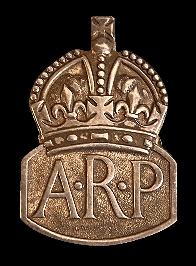 An ARP logo pin badge.