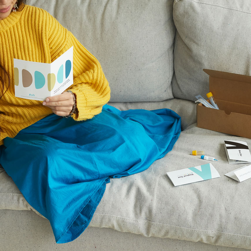 Woman sitting on the couch with Ash testing kit