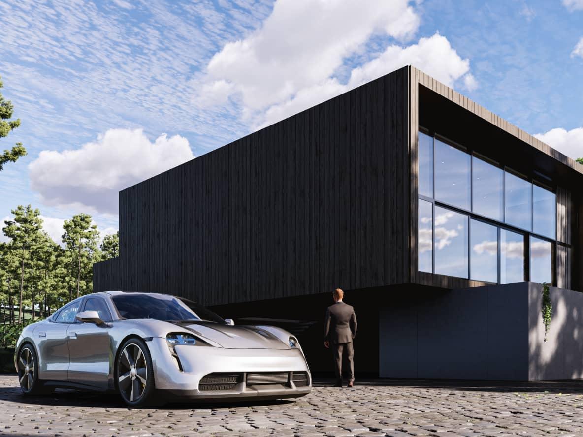 Sportowy samochód zaparkowany obok nowoczesnego budynku z panoramicznymi okanmi