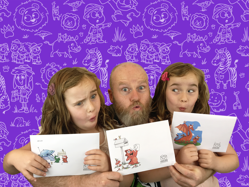 Simon with twins and envelope.png