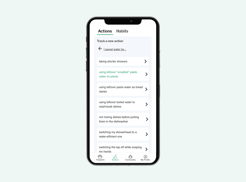 Smartphone with Pawprint's carbon-reducing actions dashboard on screen