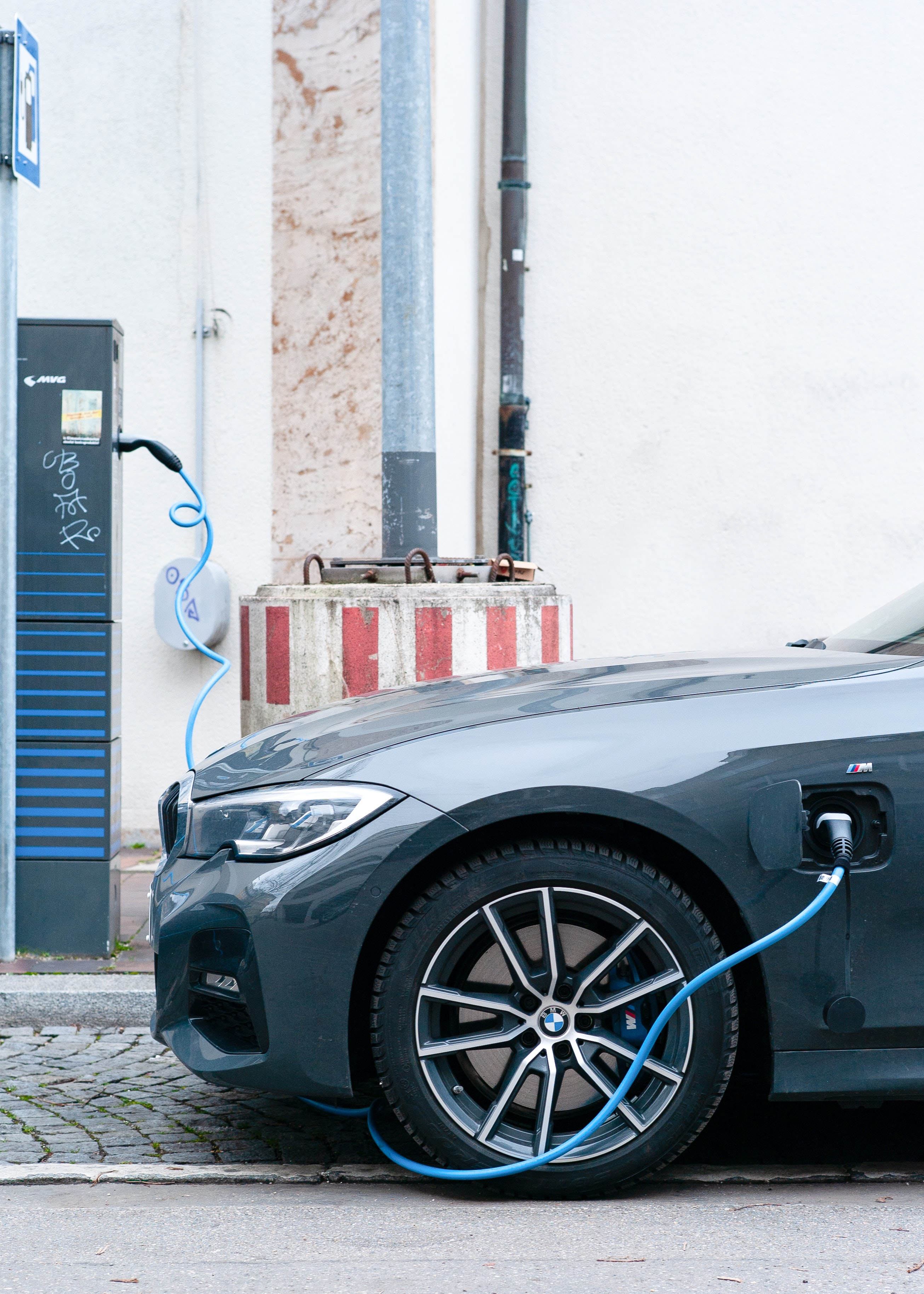 Electric vehicle plugged in at a charging point