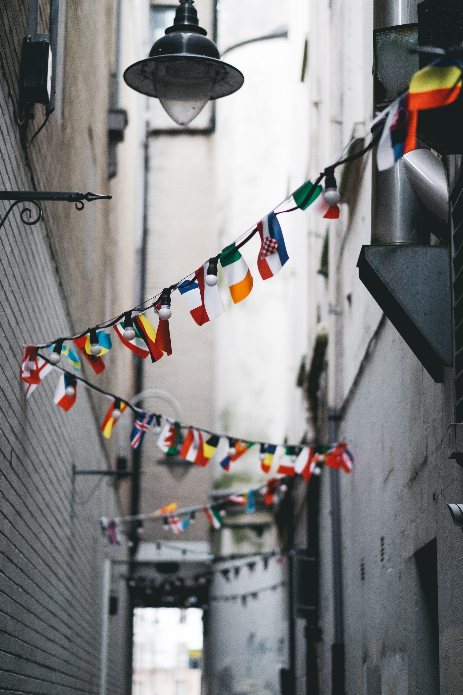 Narrow street with flag bunting zig zagging across it