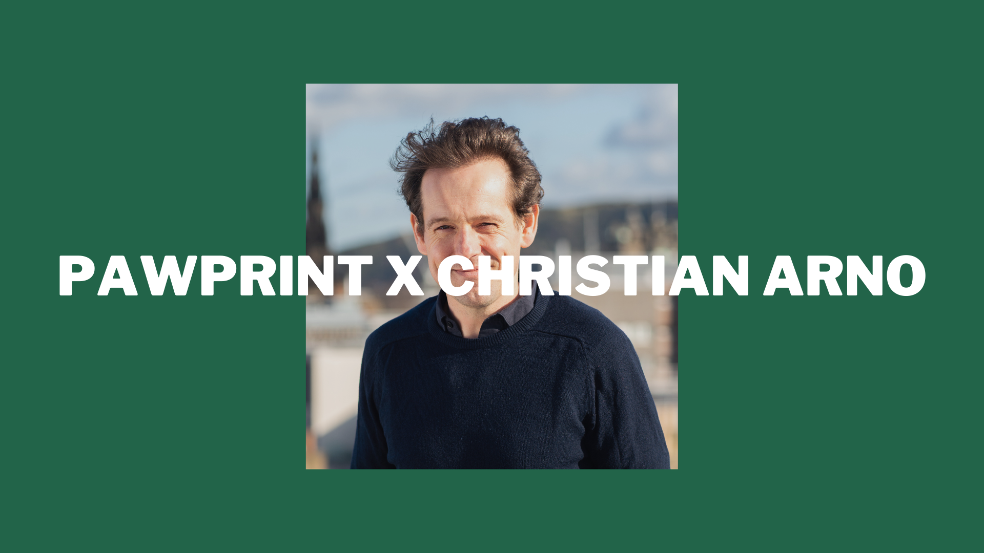 "Headshot of Christian and ""Pawprint x Christian Arno"" overlayed"