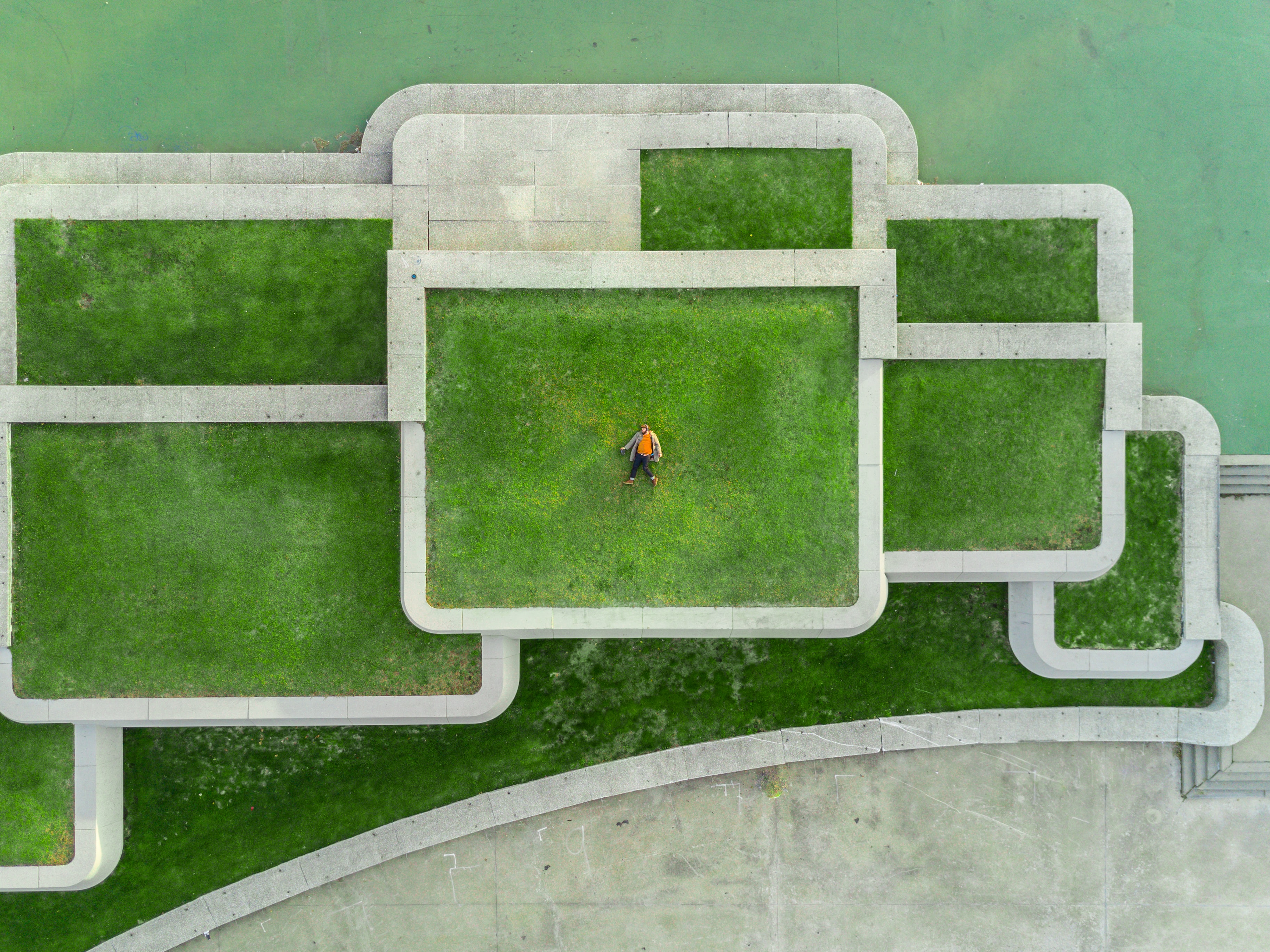 Man lying on green rooftop