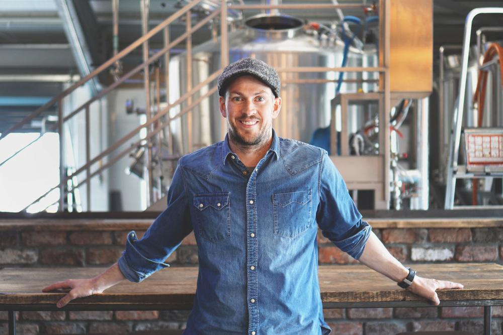 Medium shot of Brewdog CEO, James Watt inside a brewery