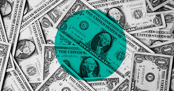 A lot of dollar bills with a big turquoise circle at the center