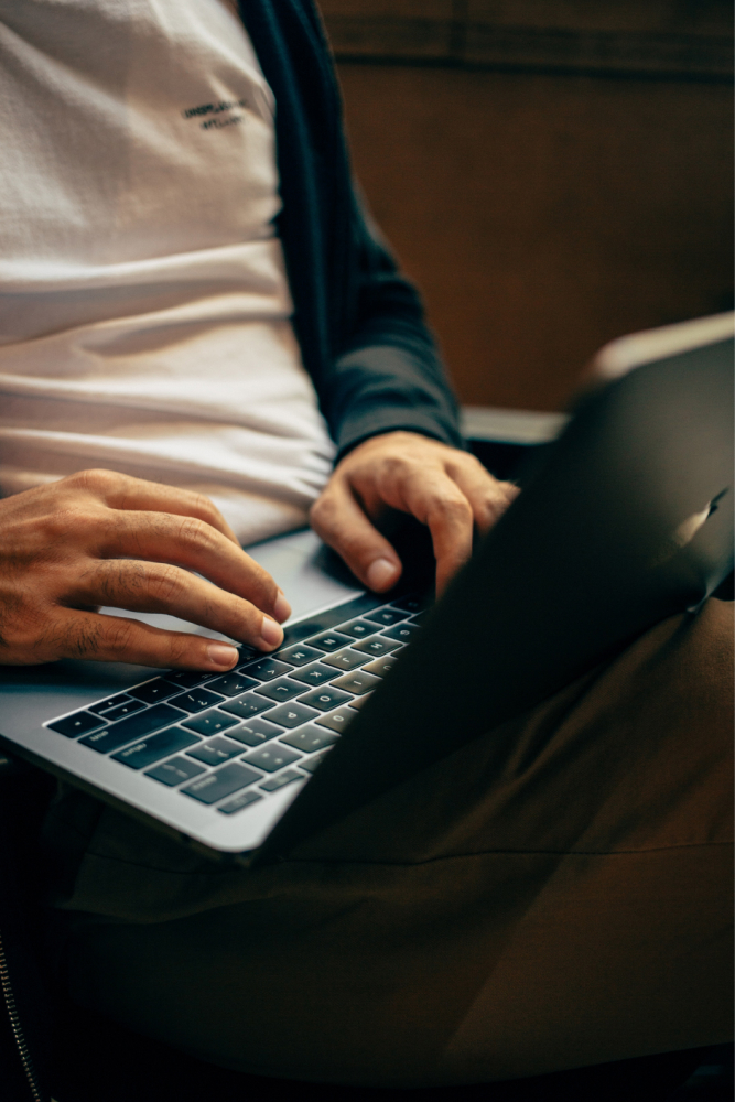 Man with laptop open