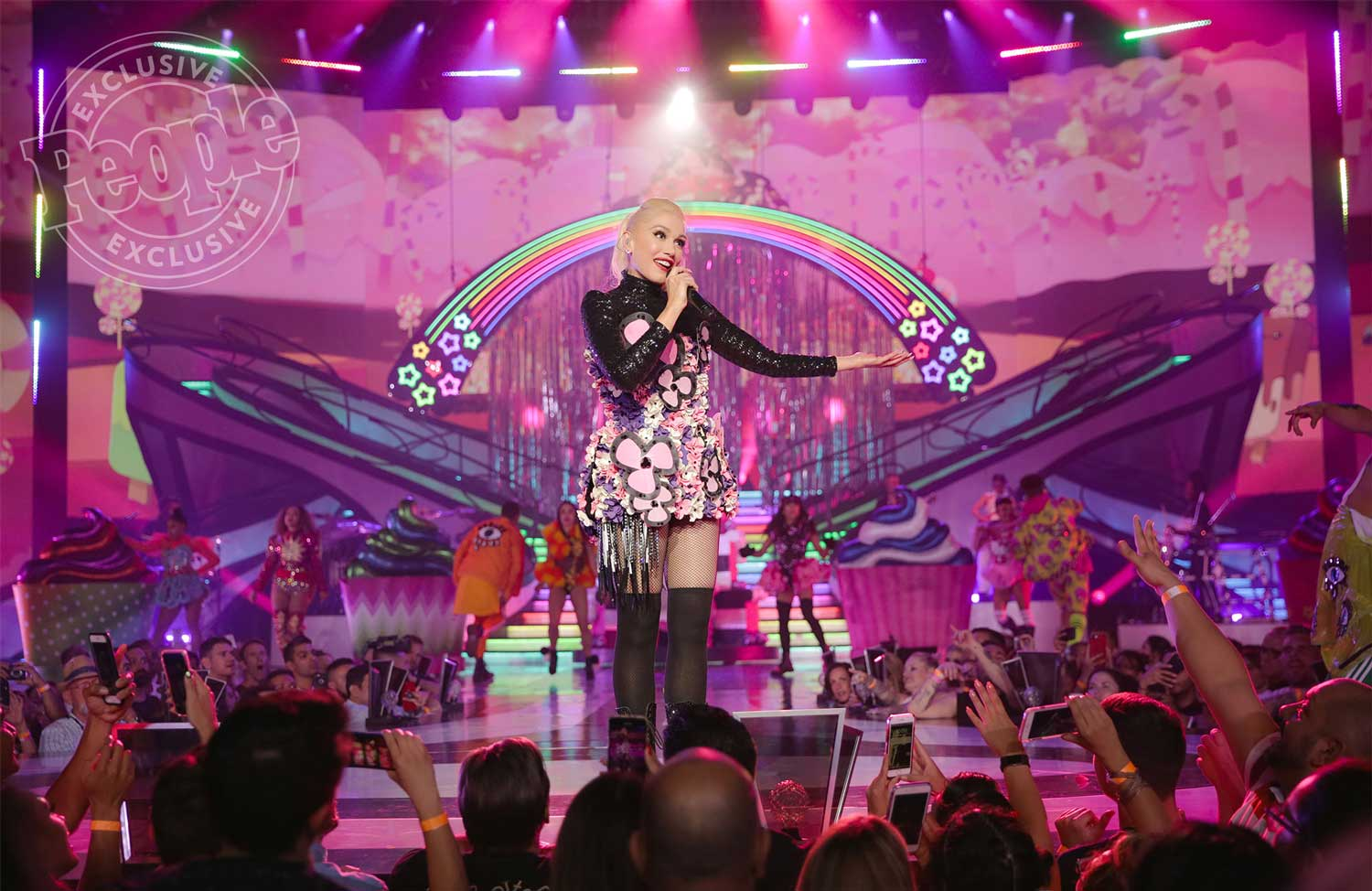 Gwen Stafani performing at her residency in Las Vegas on a pink stage.