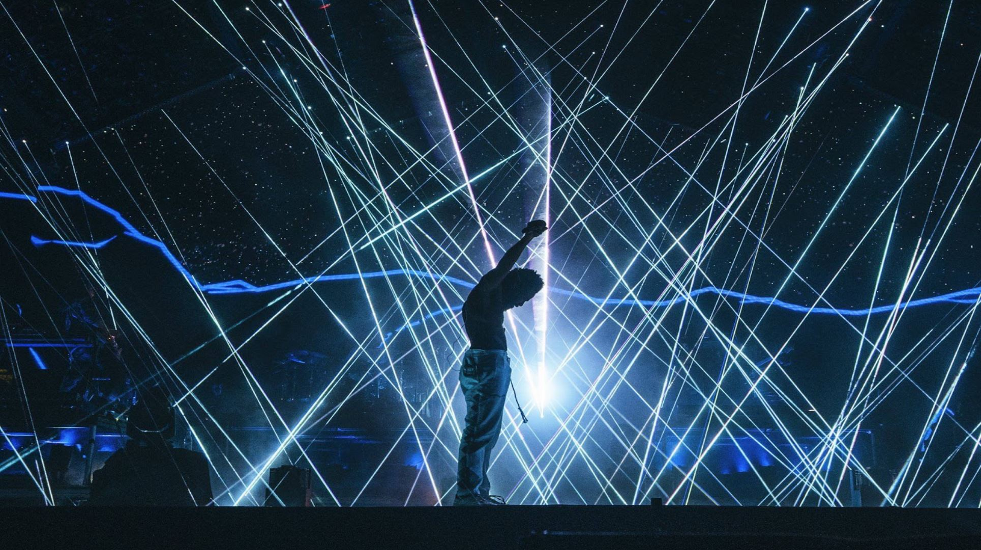 Childish Gambino performing with lasers.