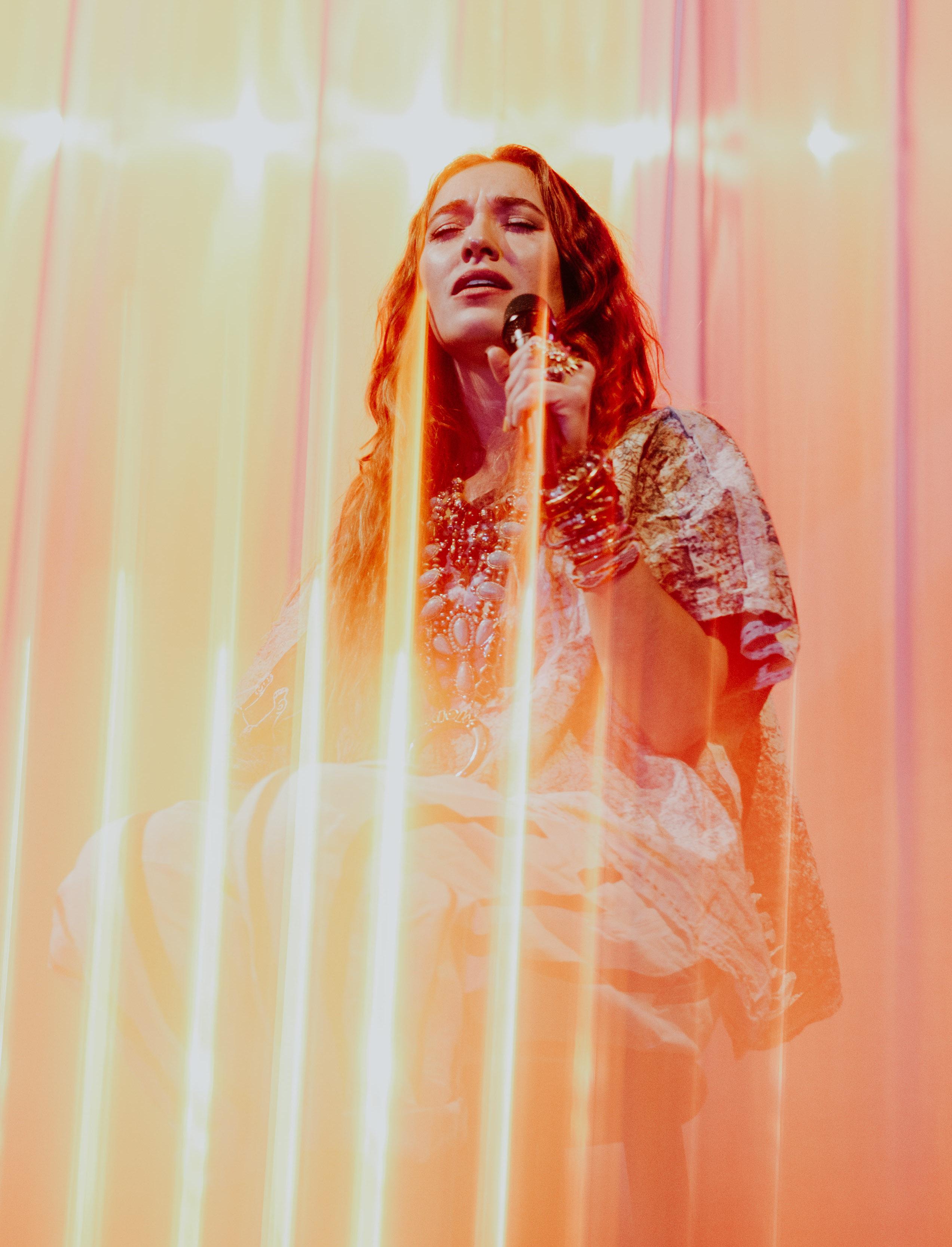 Lauren Daigle obscured by beautiful lighting.