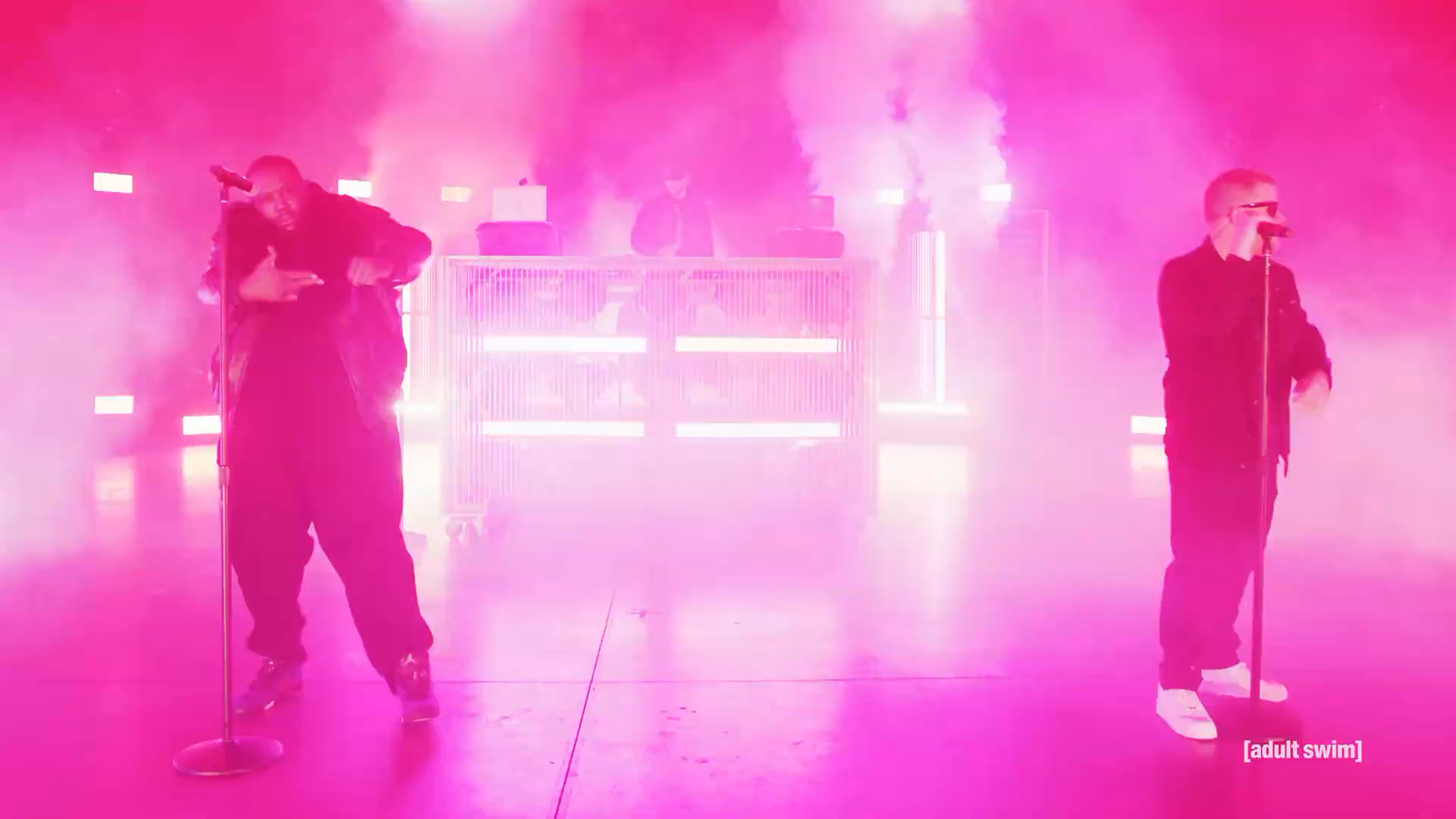 Run the Jewels performing with a predominantly pink background.