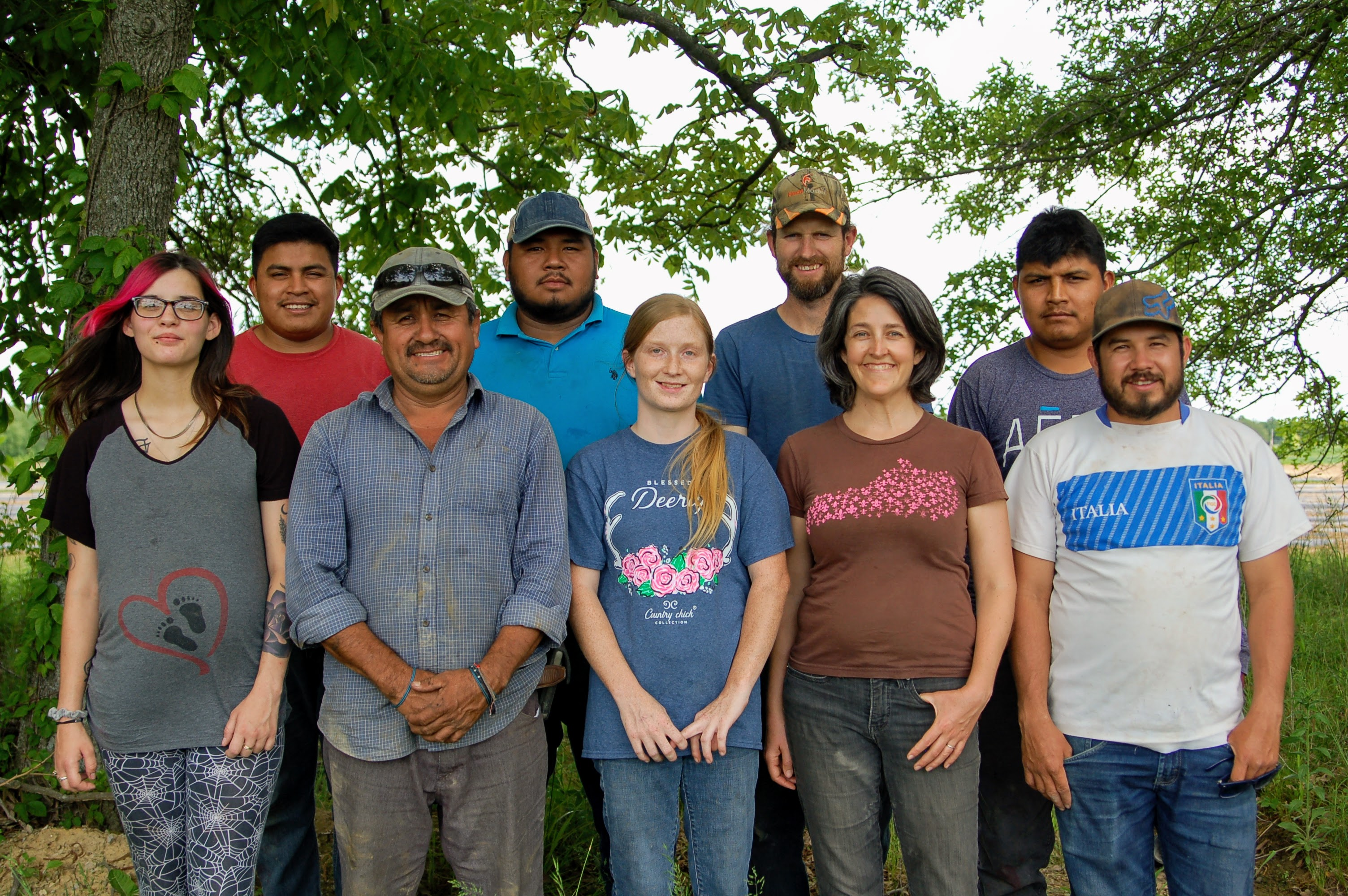 Team photo of Barr Farms farmers who work together to bring great produce and meats for those interested in local farms near me, organic farms near me and local meat farms near me.