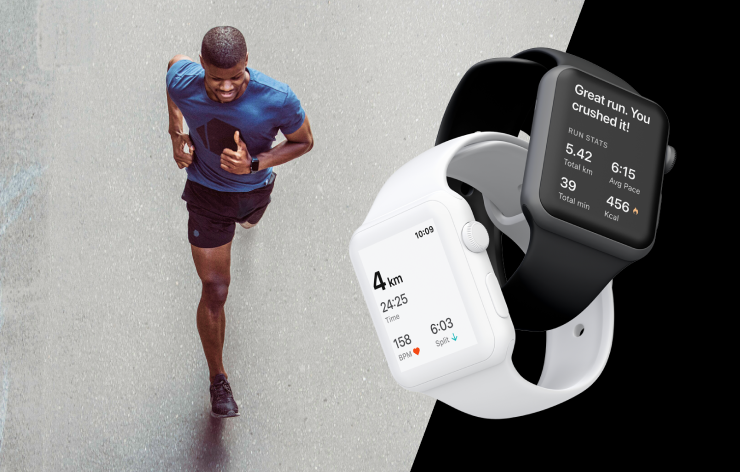 Top view of a man running down a street while smiling, with two apple watches placed over top of the photograph displaying run app screens