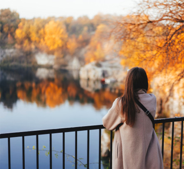 A woman looking over a lake