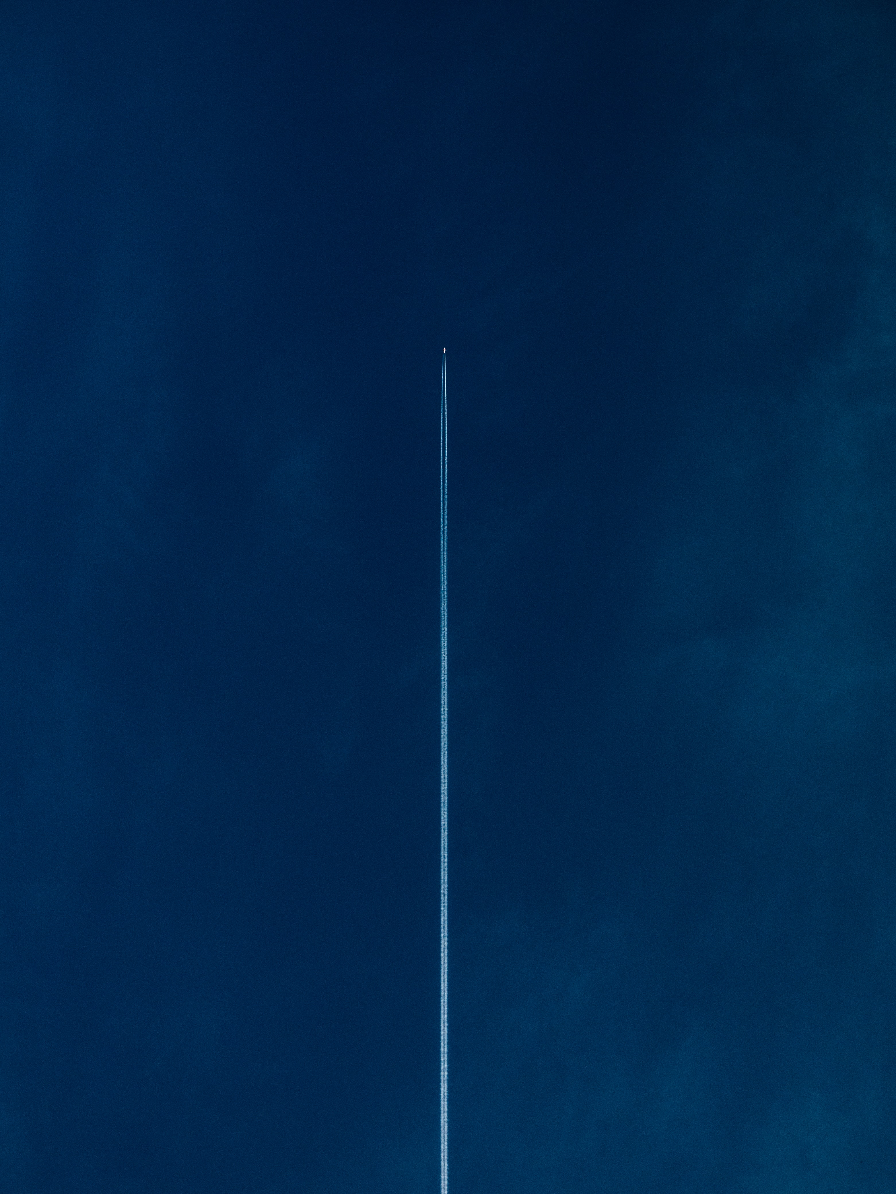 Precision performance - rocket launching into blue sky
