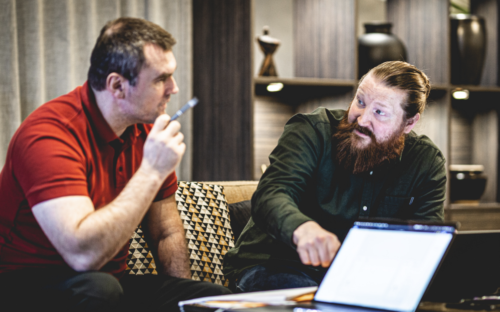 UX Designer Joona discussing with a client during a workshop.