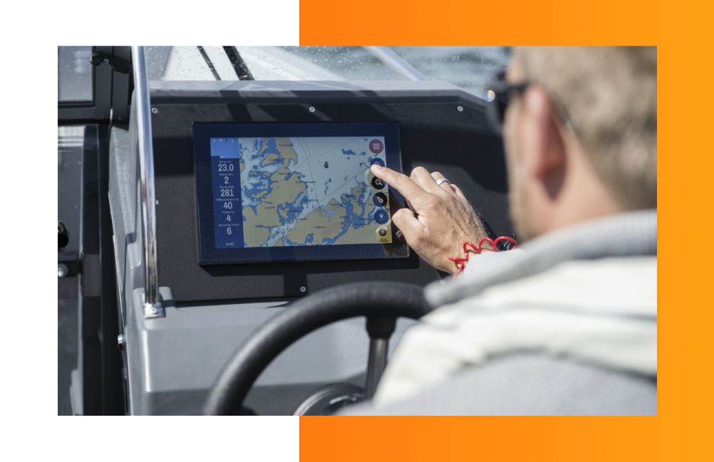 A man using a navigation software on a boat.