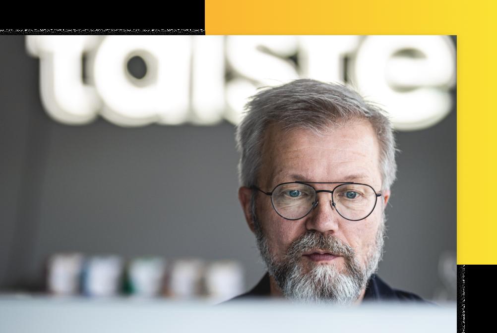 A photo of Harri Kaasalainen working at the office.