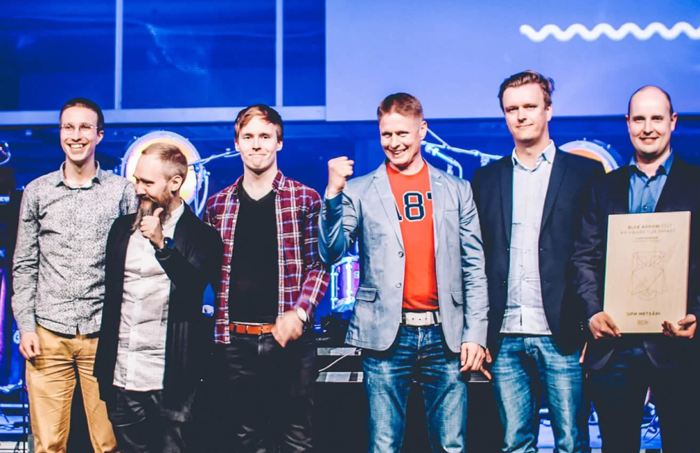 Taiste team and UPM team receiving an award for the UPM Metsä app.