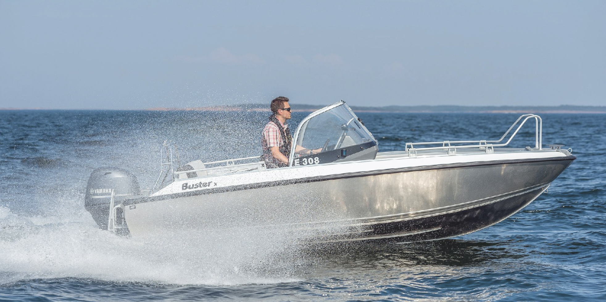 A person driving a Buster boat.