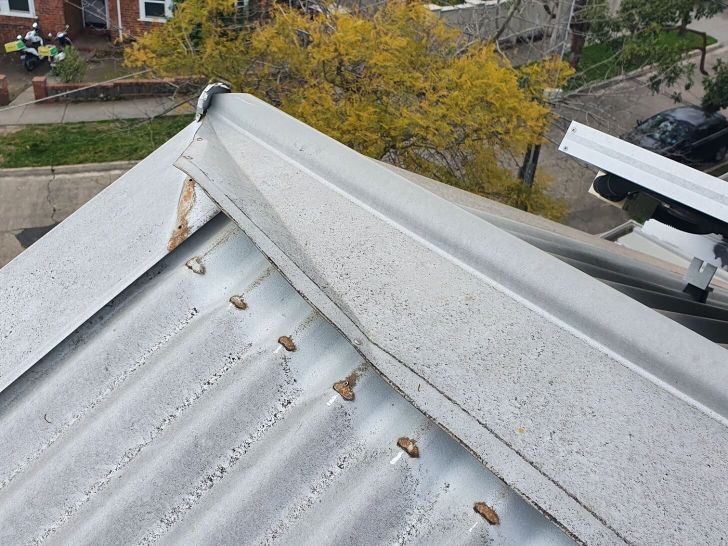 Damaged flashings on a leaking roof