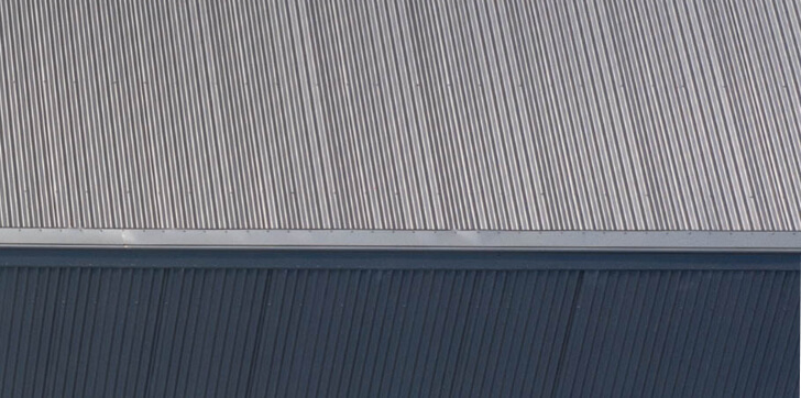 A birds eye view of a metal residential roof