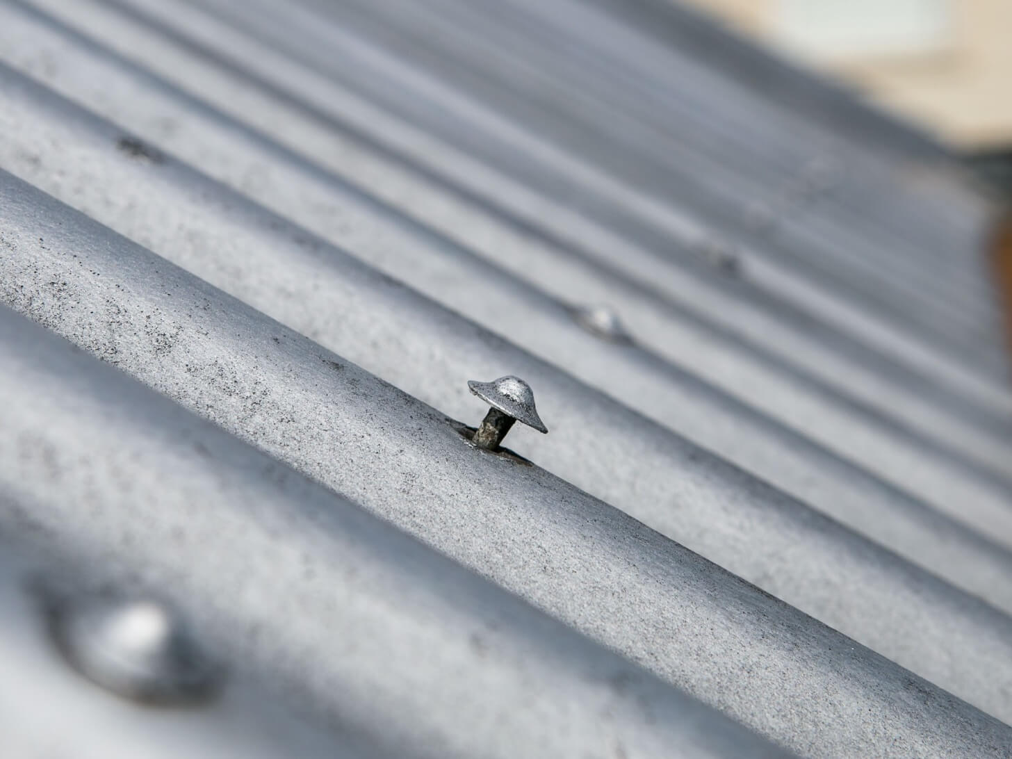 Lifted nails on a leaking roof