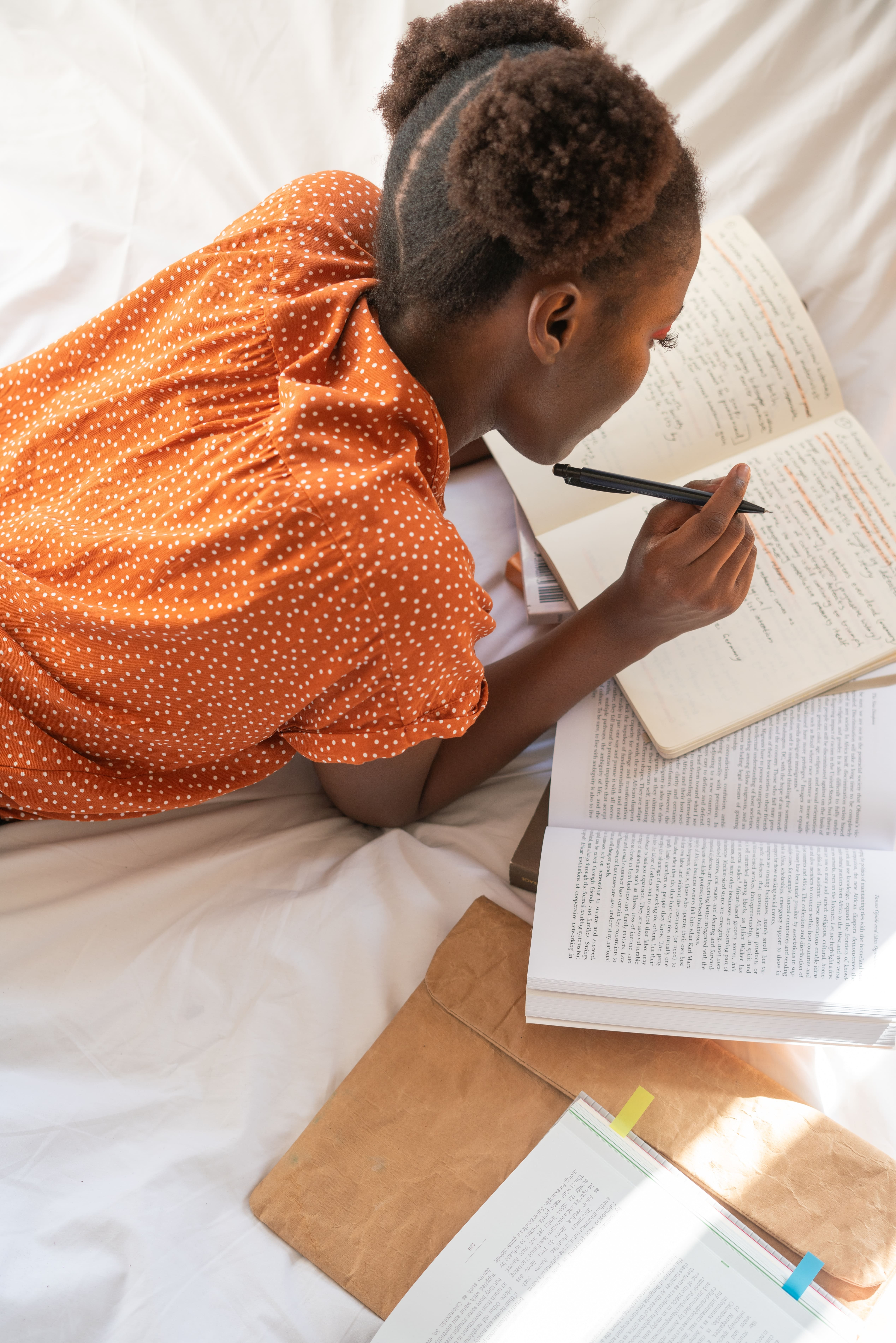 A photo of a girl writing in her notebook.