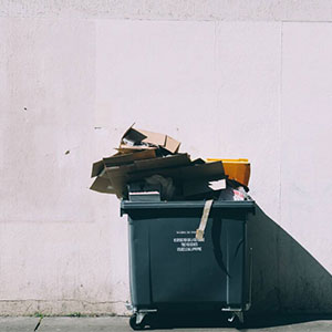Trash bin full of paper and carton boxes.
