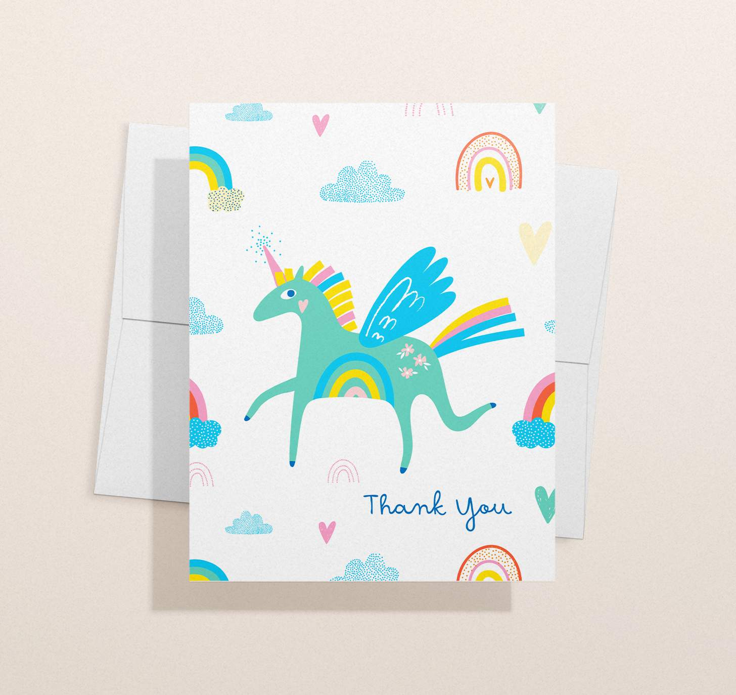 Colorful green unicorn design with envelope