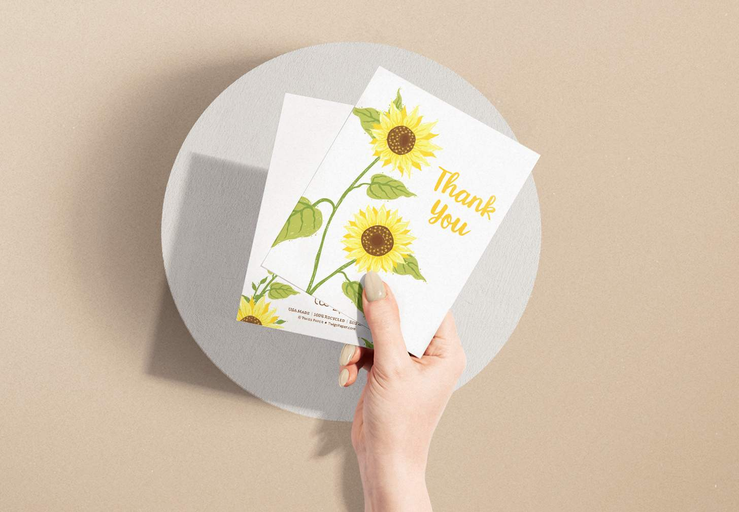 Hands holding Two yellow sunflower design with brown background