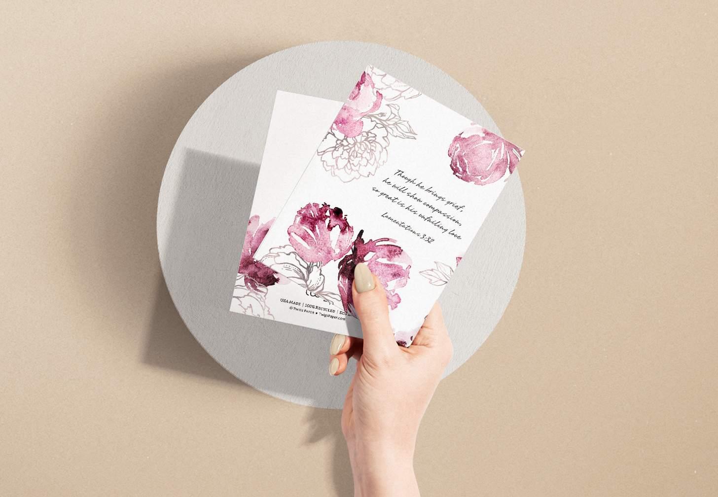 Hands holding Pink floral themed sympathy design