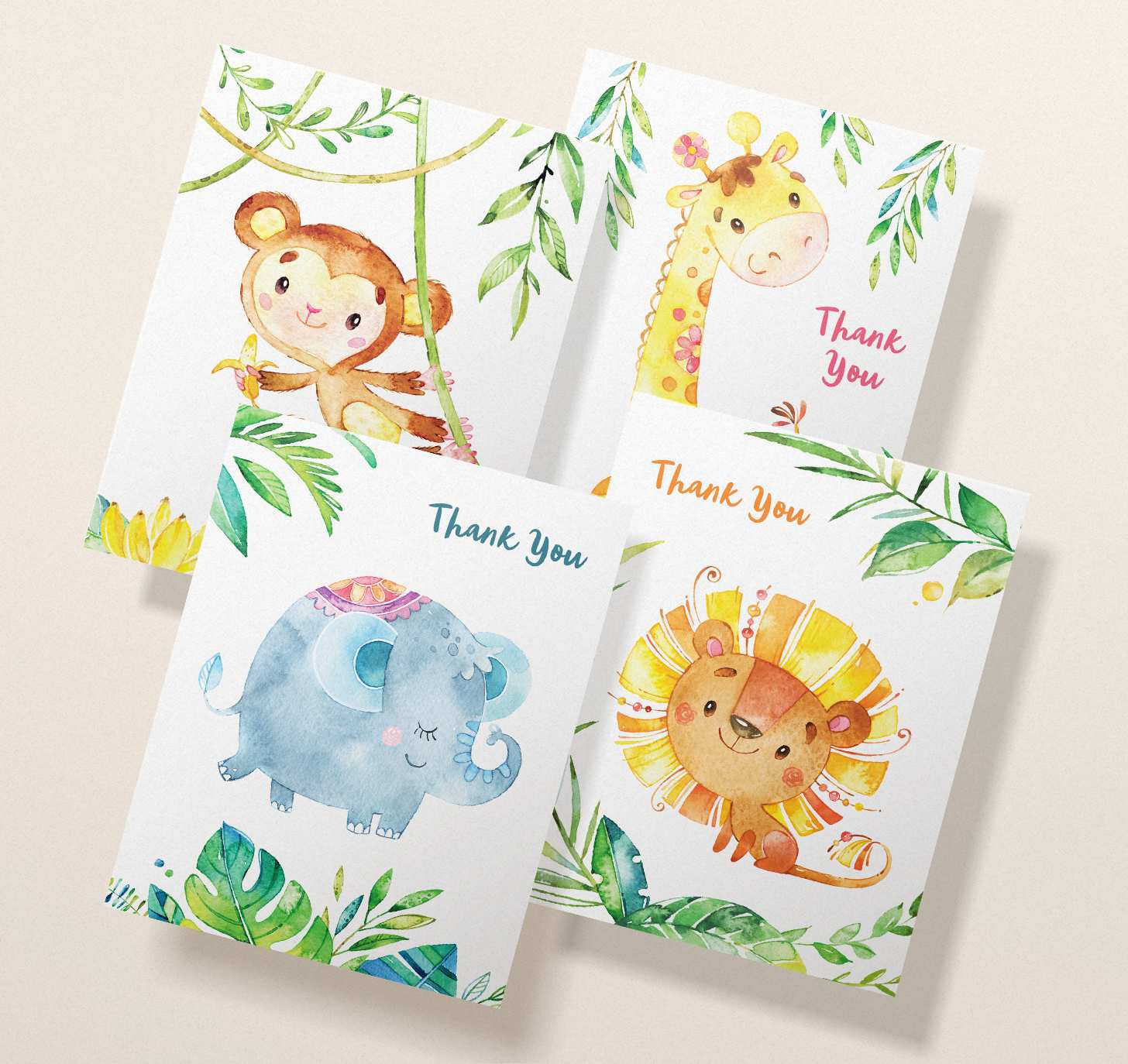 Four overlapping cards with cute lion, monkey, giraffe, and elephant designs