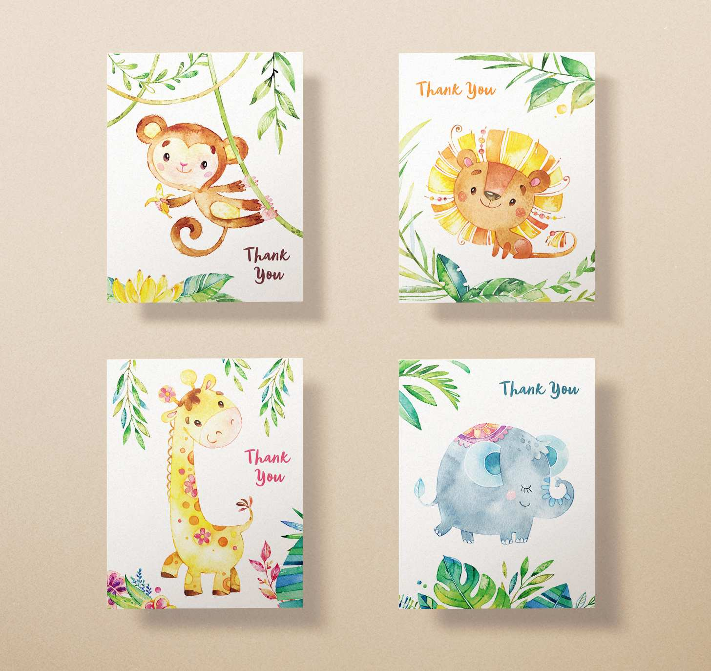 Four cards with cute lion, monkey, giraffe, and elephant designs on brown background