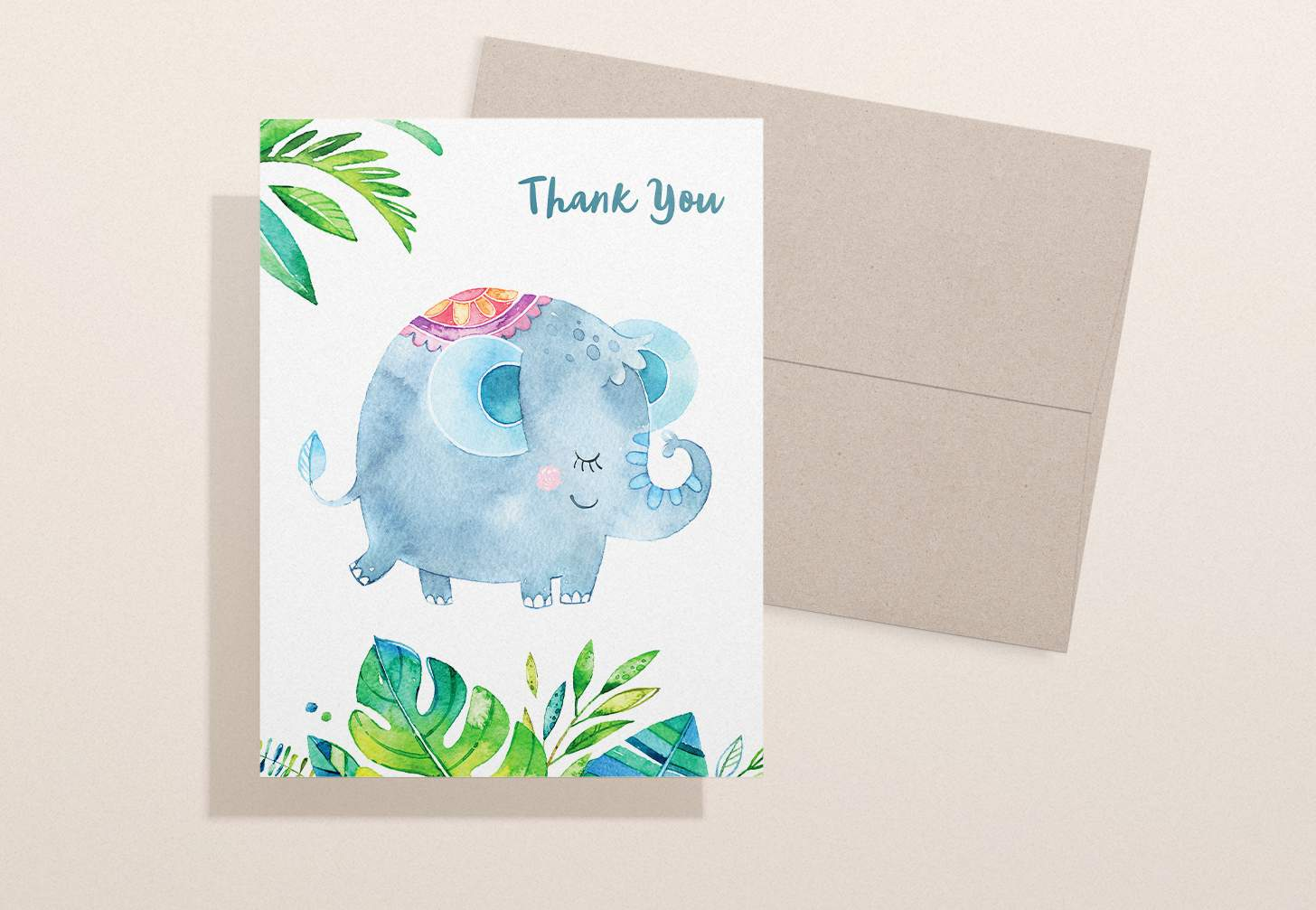 Blue elephant with green leaves design and a brown envelope
