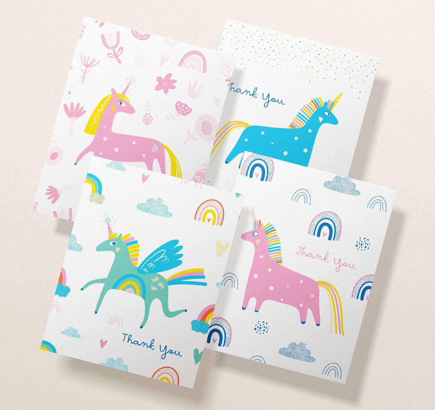 Four overlapping cute unicorn cards with assorted designs