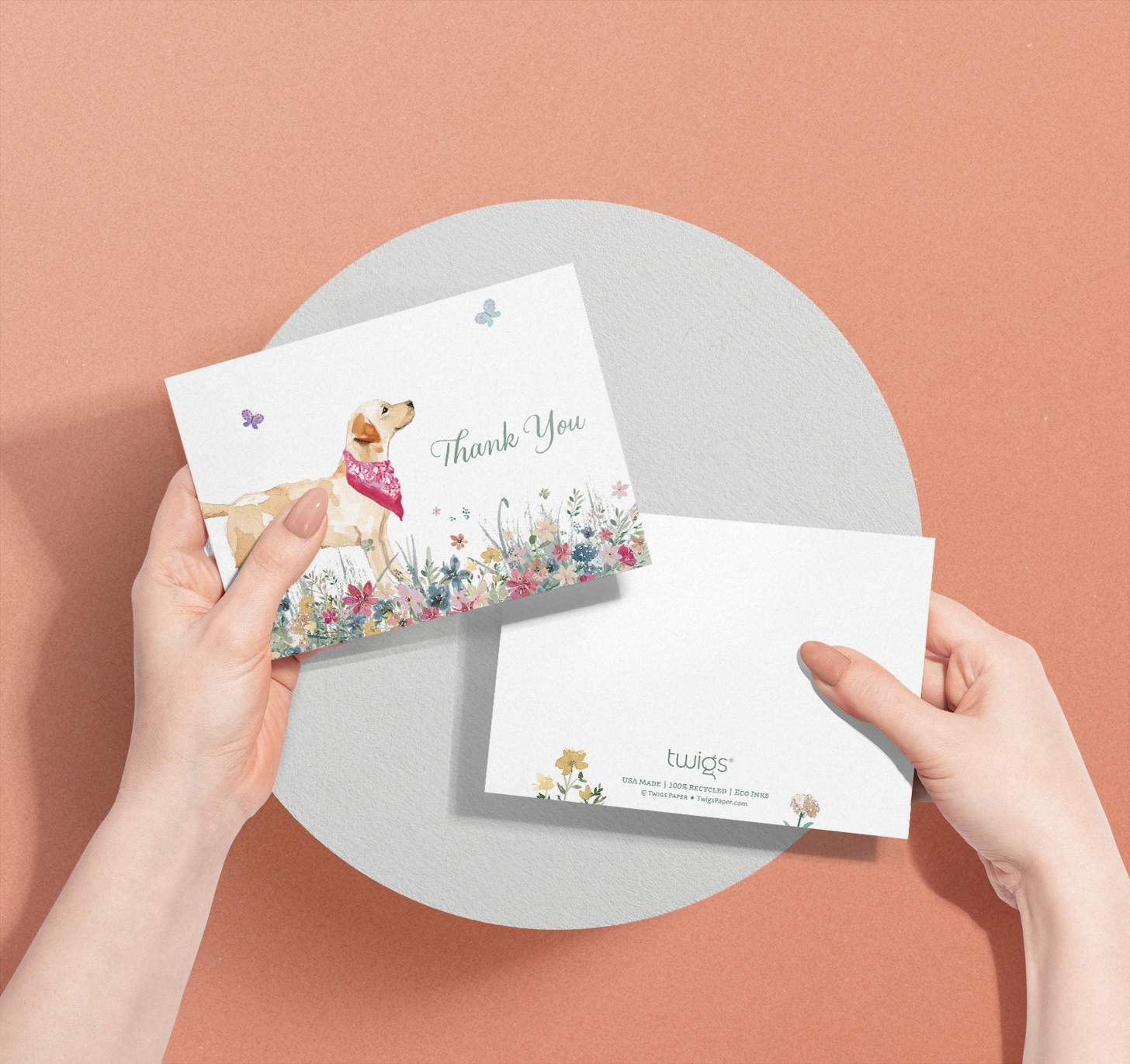 Woman's hands holding card with golden Labrador design