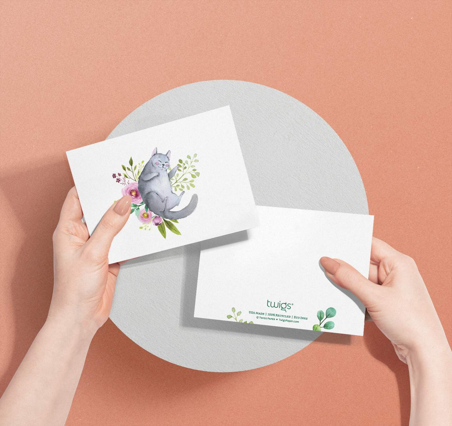 Hands holding Gray cat with flowers design card