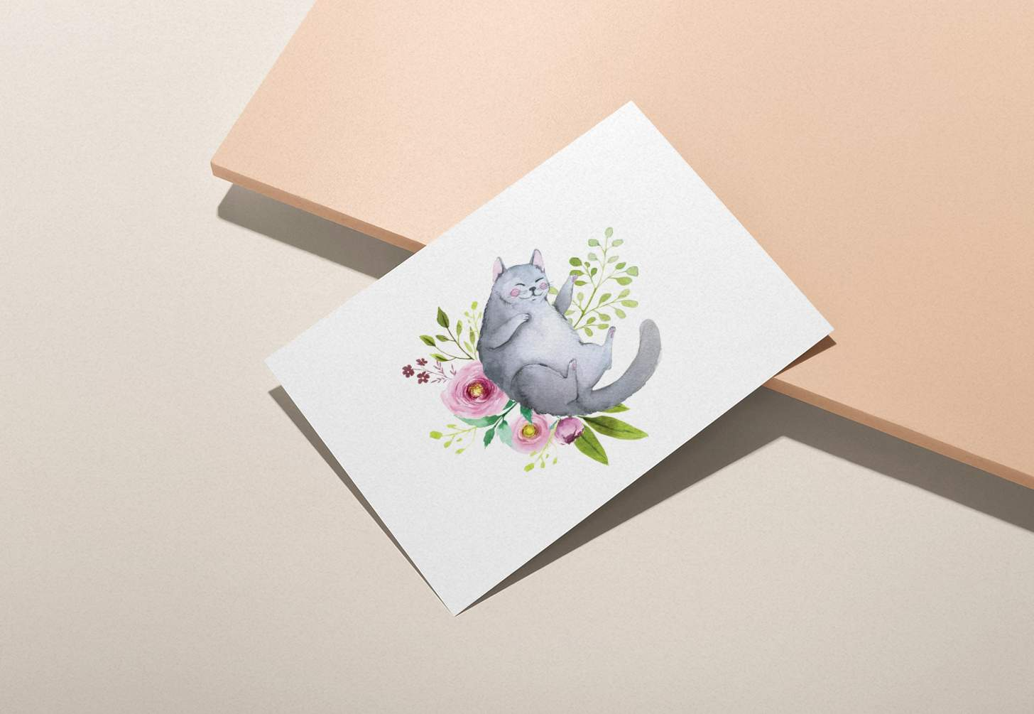 Gray cat with flowers design card on pink background