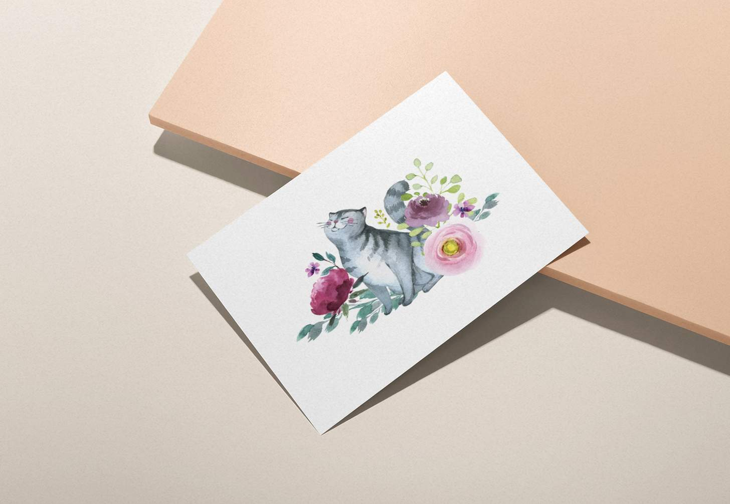 Gray striped cat with flowers design card on pink background