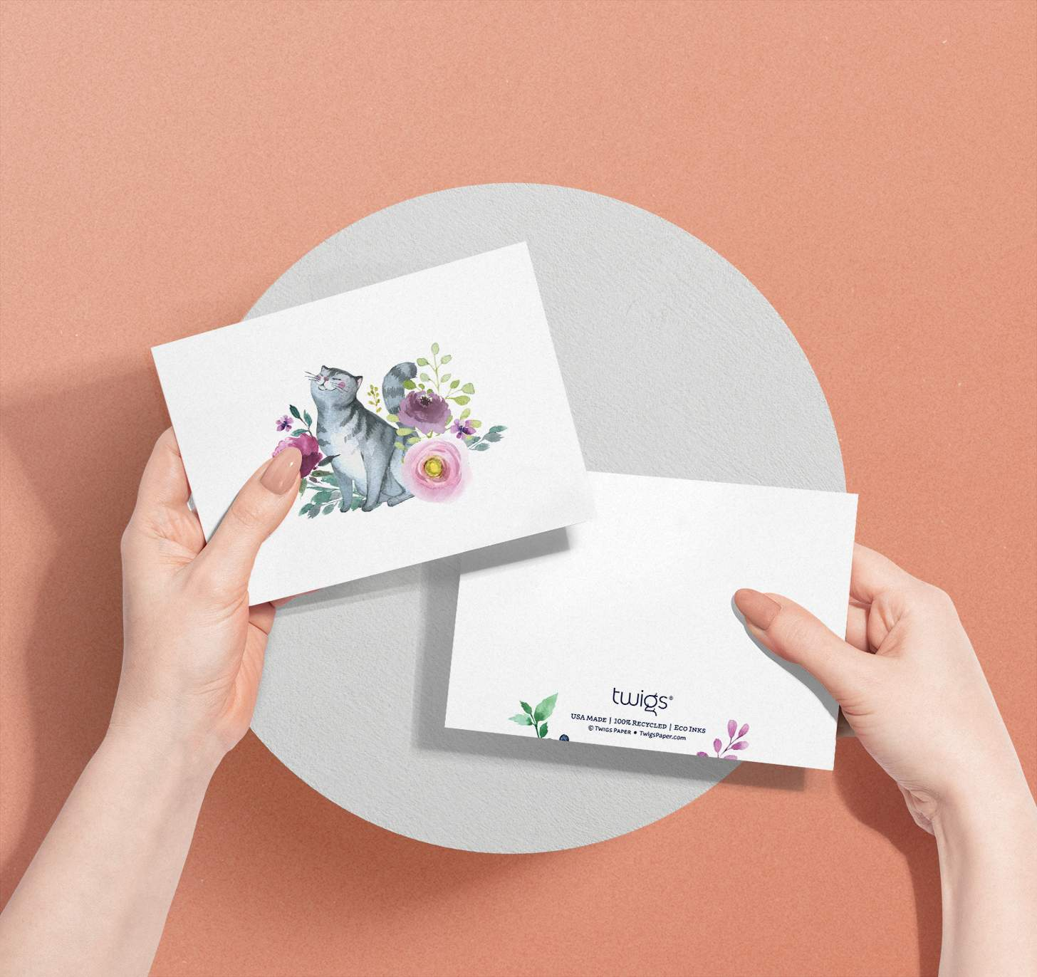 Hands holding Gray striped cat with flowers design card