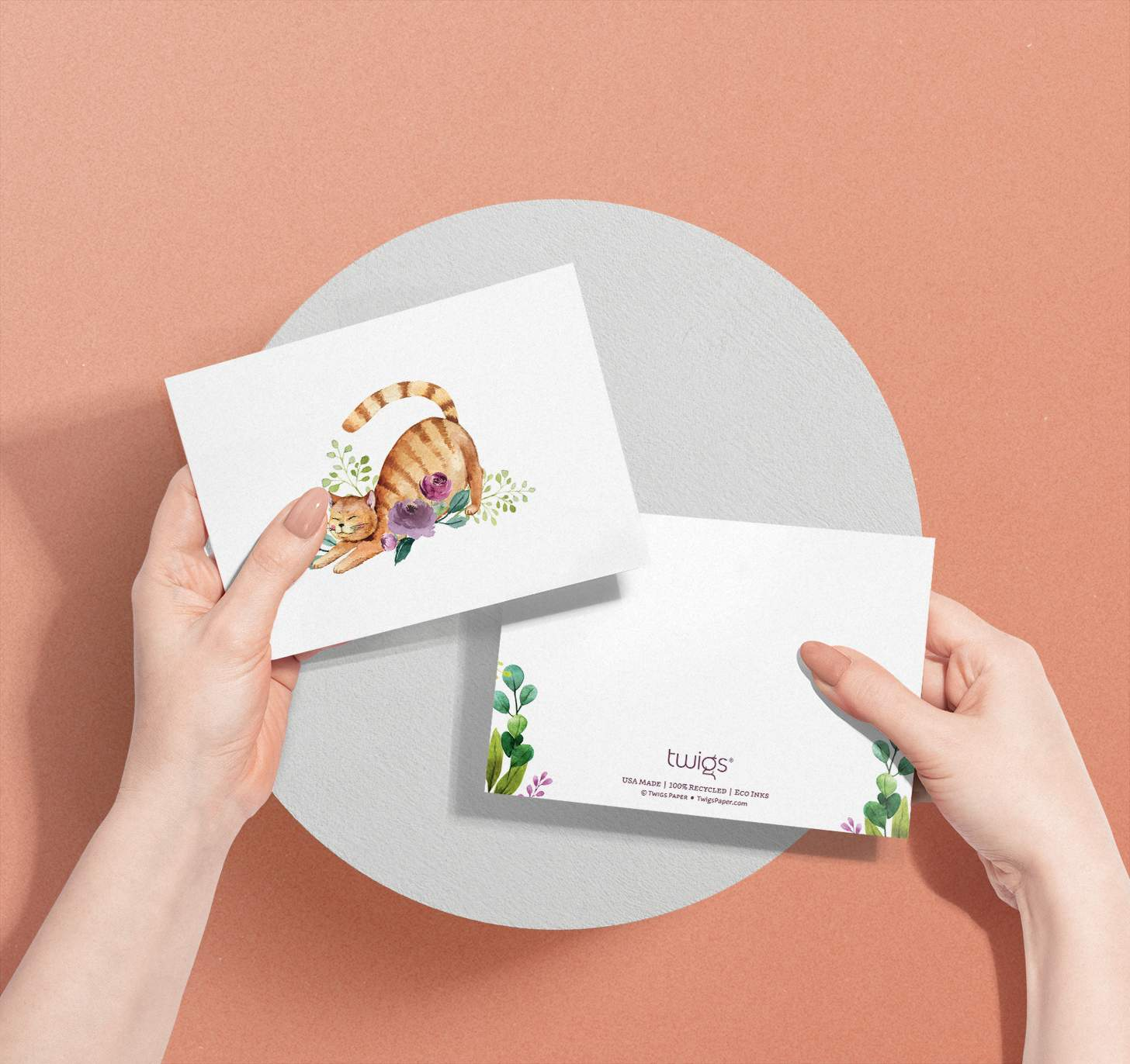 Hands holding Orange striped cat with flowers design card